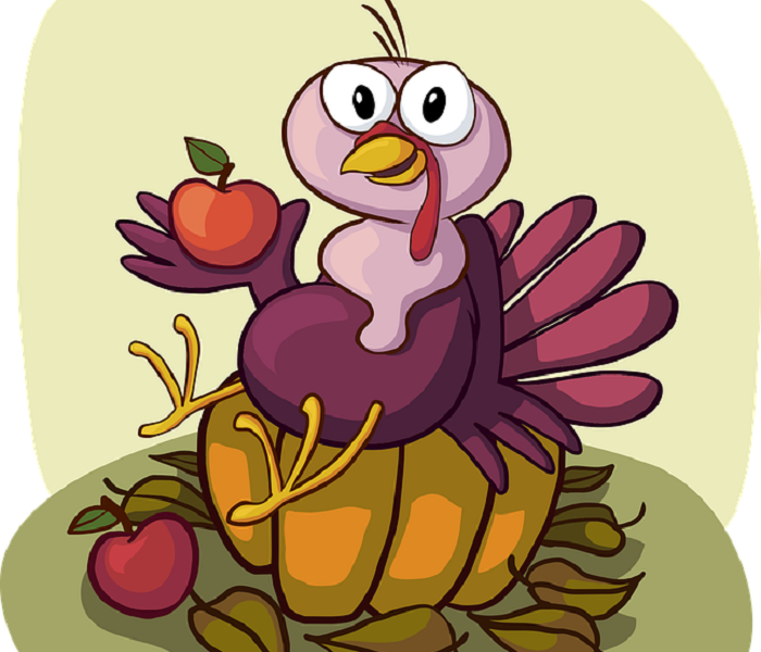Cartoon drawing of turkey holding an apple and sitting on a pumpkin.